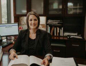 Tasha Taylor Sitting At Her Desk